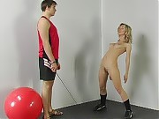 Male trainer exercises a girl in fitball sports