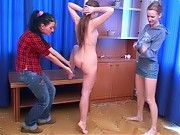 Nude backbending trainee and two lesbian instructo...